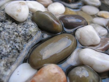 smooth stones in water